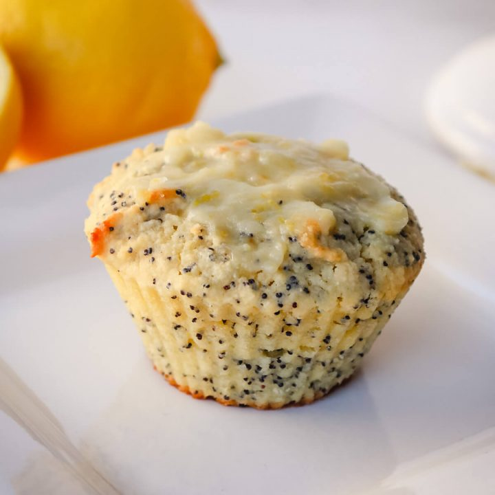 Keto lemon poppy seed muffin on a white plate