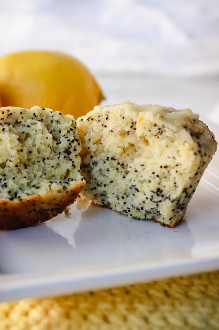 Keto lemon poppy seed muffin in half on a white plate