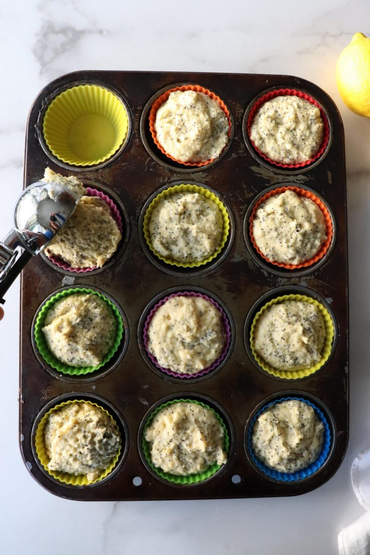 Muffin tin with keto lemon poppy seed muffin batter
