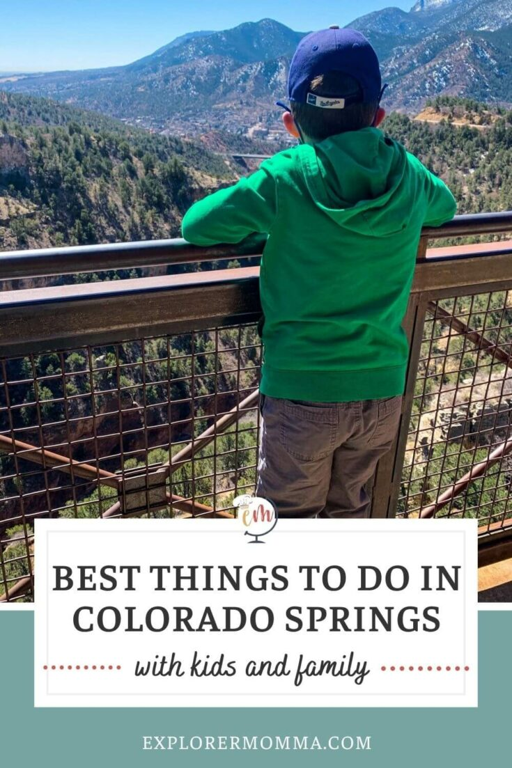Best things to do in Colorado Springs with kids and family. A boy looking out over a view at Cave of the Winds.