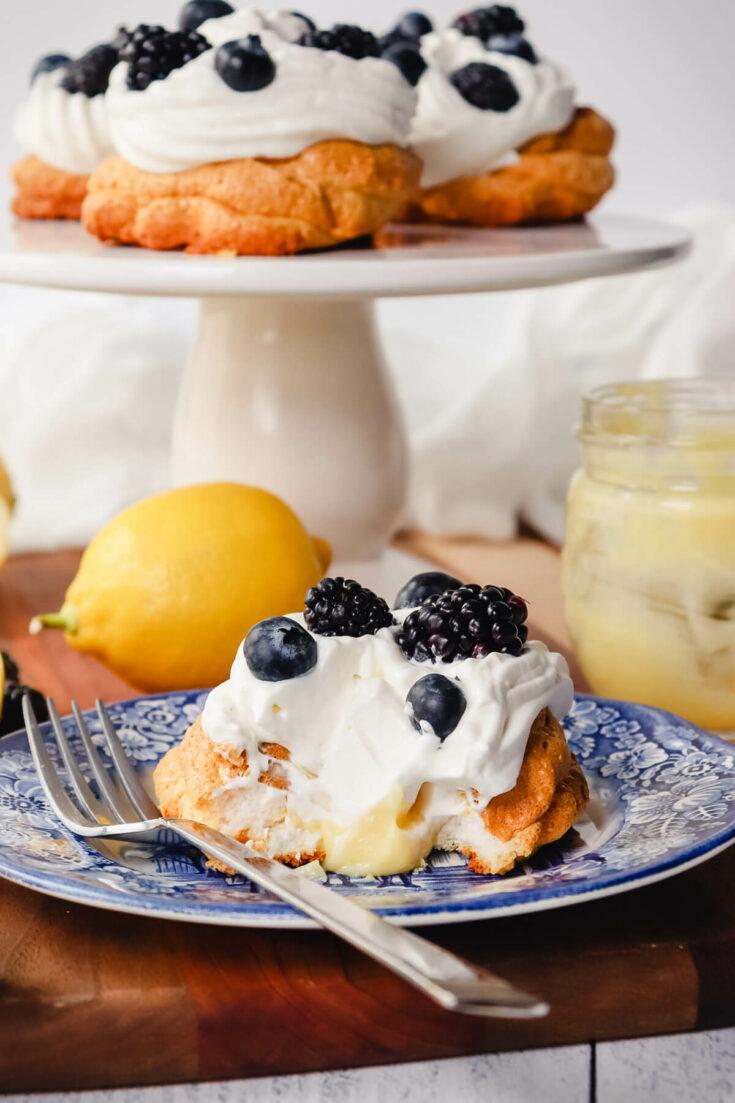 Keto lemon curd meringue nests on a plate and pedestal
