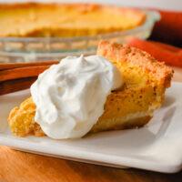 A piece of keto pumpkin pie on a plate