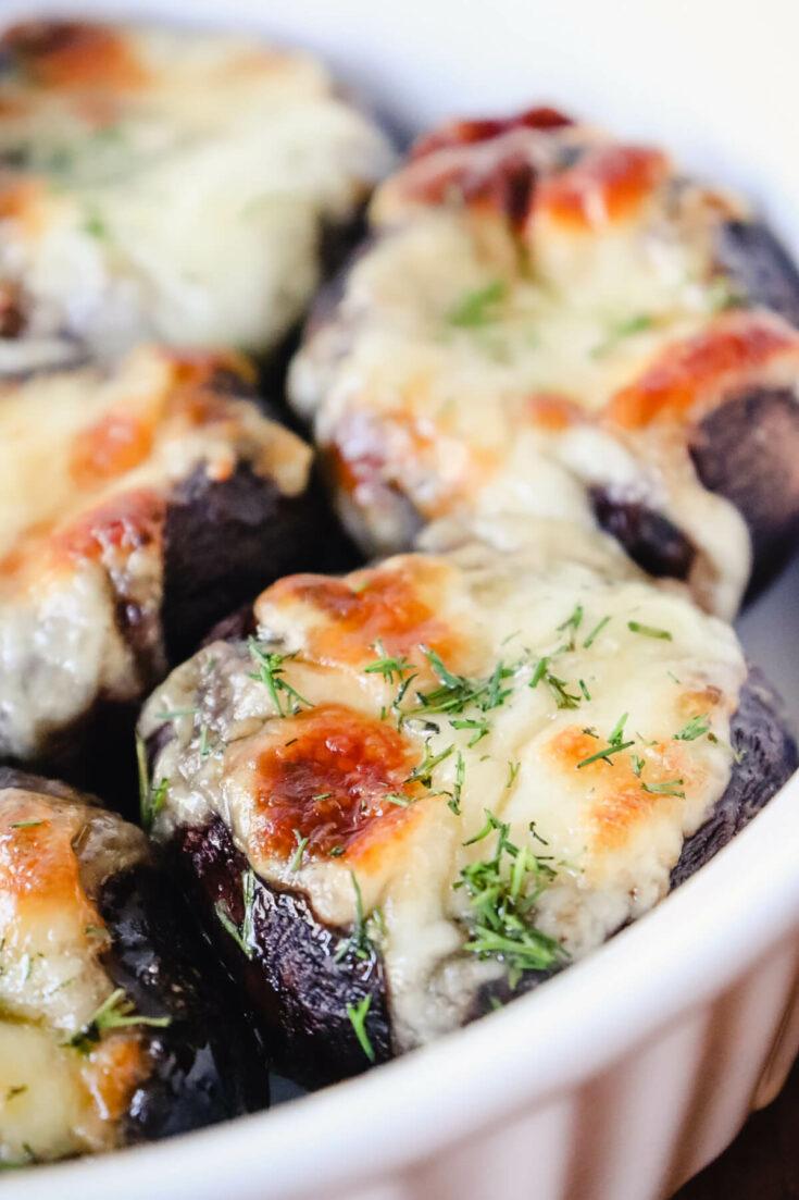 Keto mushroom recipes - stuffed mushrooms with cheese in a dish
